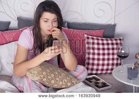 Depressed Woman With Cellphone