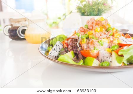 Mixed tuna salad with fruits vegetable and low calories salad dressing