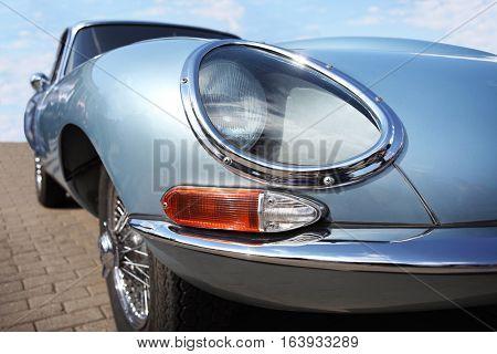 Jaguar retro car and Lucas headlight at motor show, Belarus, Minsk, may, 07.2016: International festival of retro cars