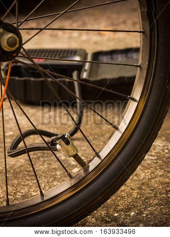 Inflating bicycle tire with air power pump