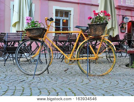 Yellow vintage bike in the street of Sighisoara Romania