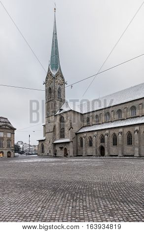 Zurich, Switzerland - 3 January, 2017: Munsterhof square and Fraumunster cathedral in the historical part of the city on an overcast day in winter. Zurich is the largest city in Switzerland and the capital of the Swiss canton of Zurich.