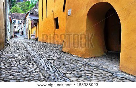 SIBIU ROMANIA - MAY 5: Empty street in city centre of Sighisoara Romania on May 5 2016. Sibiu is the city located in Transylvania region of Romania.