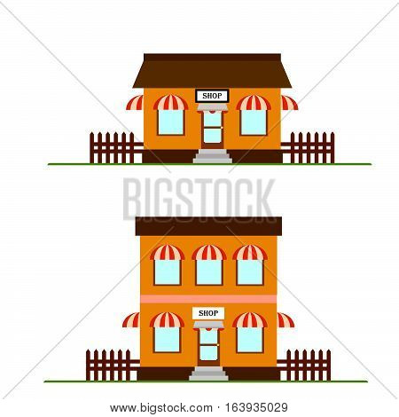 2 village shop facades with fence and green grass