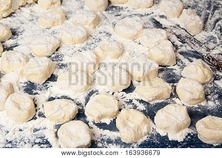Making Homemade Gnocchi. Uncooked Trickled Pastries In Flour
