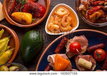 Spanish Tapas Starters On Wooden Table