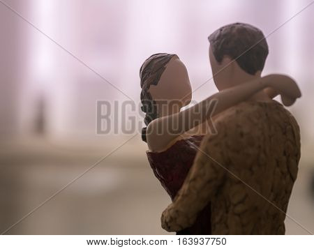 wooden dummy couple hug eachother love care purple tone with copy space