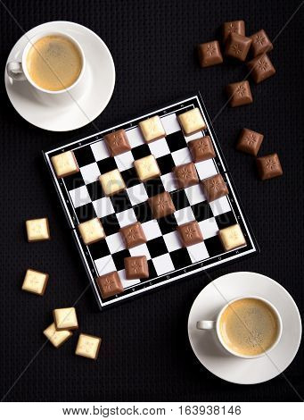 Coffee and chocolate on the chessboard creativy