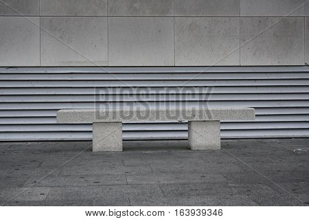 stone bench on the background of the stone façade