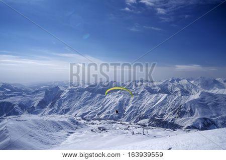 Winter in Greater Caucasus Mountains. Georgia (country). Gudauri ski resort. Paragliding.