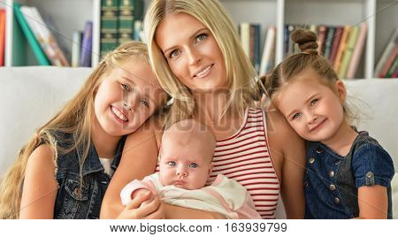 mother with her three daughters close up portrait