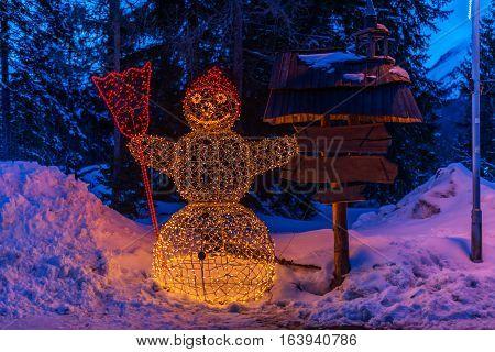 Winter in High Tatras Mountains. High Tatry. Slovakia. Vysoke Tatry. Christmas and New Year decoration.  Illuminated Snowman