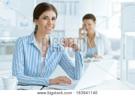 two young business woman  working at office