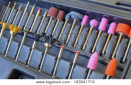 Set of different grinding and cutting accessories for mini drill machine