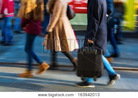 People On A Shopping Street In Motion Blur