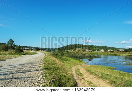 Two diverging roads in the Russian hinterland. The village Sulem on the river Chusovaya