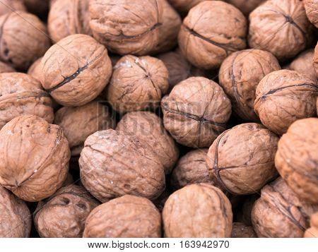 Scattered Pile Of Fresh Walnut In Market