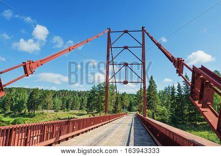 Bridge over the river Chusovaya in summer day. Russia. Ural