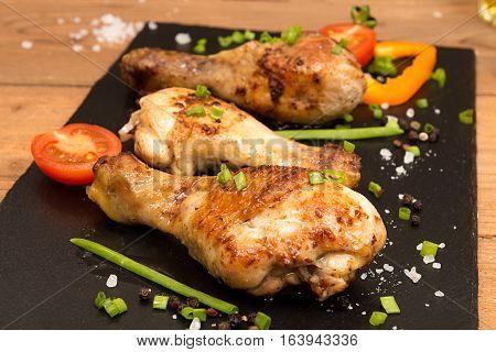 Fried Chicken Legs Garnish Cherry Tomato And Bunch-onion