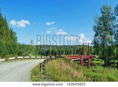 Summer landscape with a bridge over the river Chusovaya. Russia. Ural