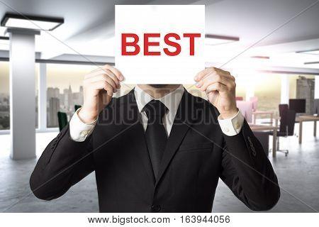 businessman in black suit hiding face behind sign best