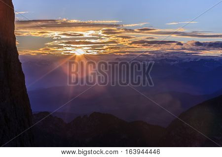 Cloudy sunset over Dolomites mountains. Italian Dolomites