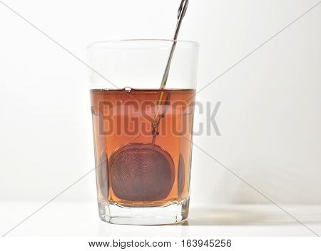 An isolated glas with tea on a White background. Copy space.