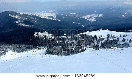 The view from the mountains in the winter sports resort a village in the mountains ski ski lift Dragobrat
