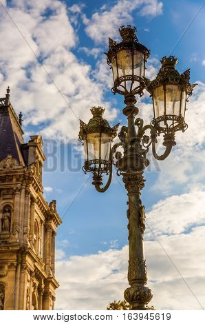 antique street lamp in front of the Hotel de Ville in Paris France