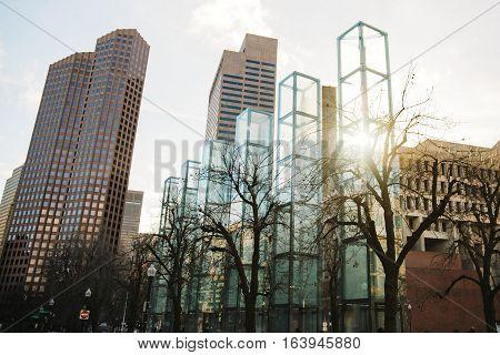 The New England Holocaust Memorial, Boston USA. six glass towers on the background of sky and city. each tower symbolizes a different major extermination camp (Majdanek, Chełmno, Sobibor, Treblinka, Bełżec, and Auschwitz-Birkenau)
