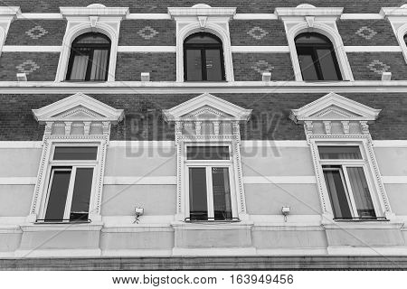 facade with windows in ancient style. vertical shot