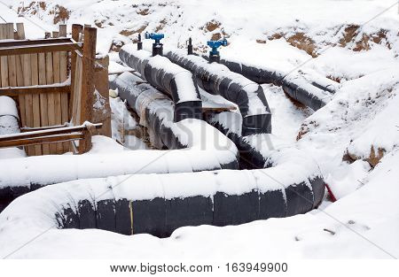 New water pipes with insulation mounting in a ground in a winter day