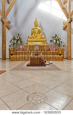 Hemel Hempstead England - November 2016: Inside the Temple of Amaravati Buddhist Monastery. The monastery is inspired by the Thai Forest Tradition and the teachings of the late Ajahn Chah a Thai monk a Thai monk and renowned Dhamma teacher.
