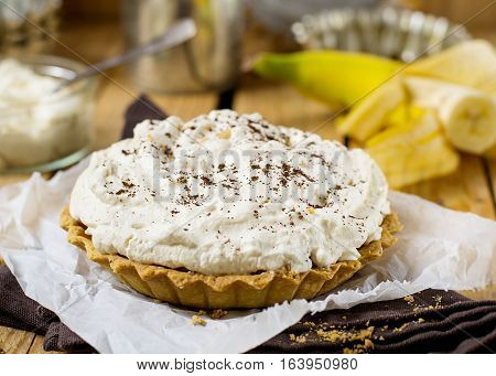 Banoffee pie with bananas whipped cream coffee and toffee