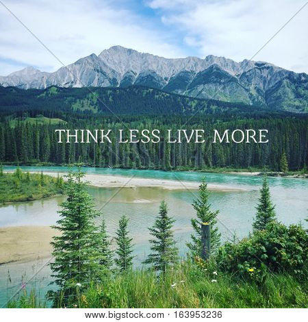 Scenic summer mountain landscape with inspirational quote in white text on lush green trees in background.  Mountains, foothills and peaks with blue sky and white clouds background.Turquoise river water and greenery in foreground.