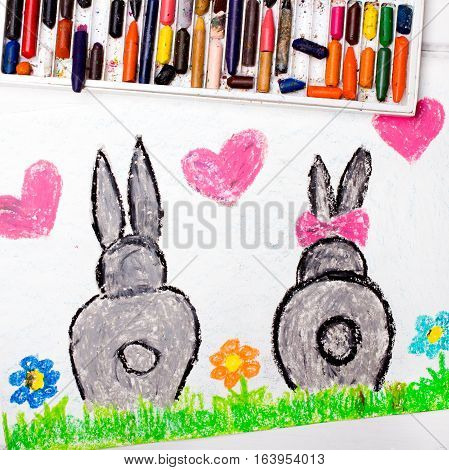 Colorful drawing: rabbits in love and pink hearts