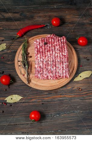 Homemade raw minced meat with herbs closeup.