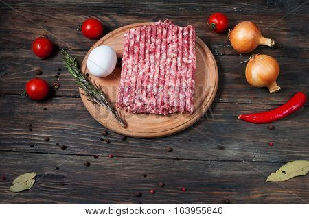 Homemade raw minced meat with egg and herbs closeup.