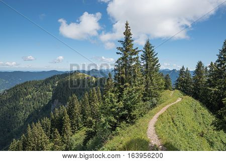 beautiful narrow hiking trail along the mountain crest brauneck upper bavaria