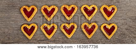 Cherry Hearts. Shortbread Cookies with Cherry Fruit Filling and Chocolate Base. Selective focus.