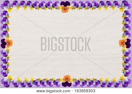 Wooden Background With Violas Frame