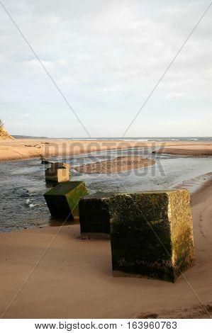 Old world war II tank defences on a Scottish beach