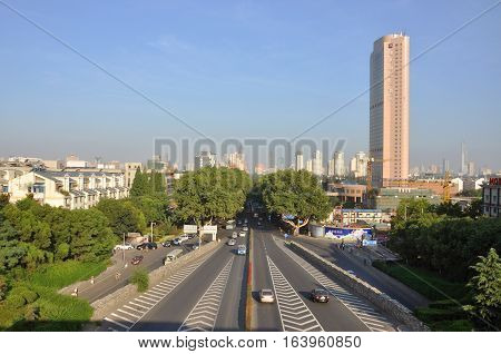 NANJING, CHINA - JUL.22, 2012: Nanjing City Skyline and Zhong Shan Dong Lu (East Zhongshan Road), viewed from Zhongshan Gate, Nanjing, Jiangsu Province, China.