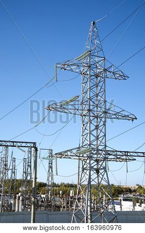 Substation with a lot of industrial electrical equipment high-voltage towers and wires