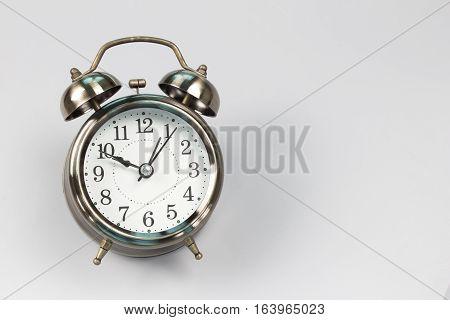 alarm clock on gray background. Vintage background with retro alarm clock gray tone