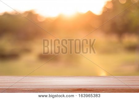 Empty Teal color wood table with backdrop blurred nature background, Can be used for display your product