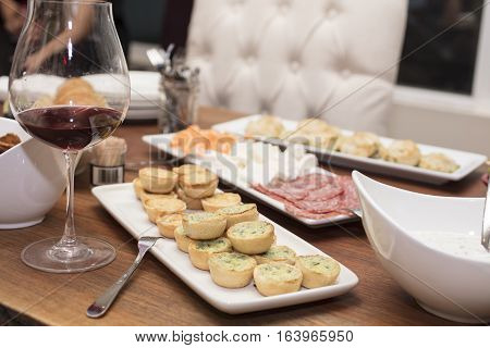 Mini spinach and cheese quiche served with other cold cut appetizers for a party gathering