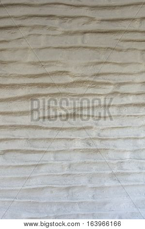 White and worn wall texture made of adobe bricks laid horizontally