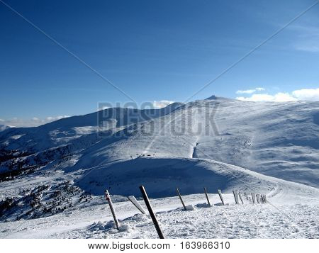 Beautiful winter landscape of snow-covered mountain range icy poles the boundary of the reserve