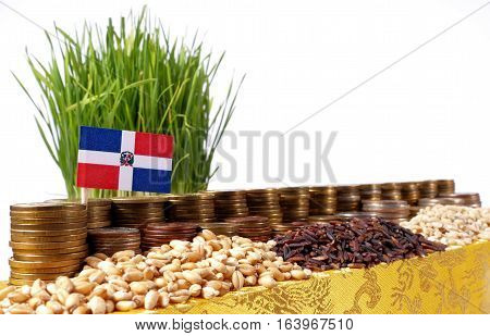 Dominican Republic Flag Waving With Stack Of Money Coins And Piles Of Wheat And Rice Seeds